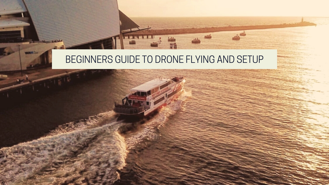 Featured image from the article on drone photography bible, Beginners Guide To Drone Flying And Setup. The image features a boat in the sunset.